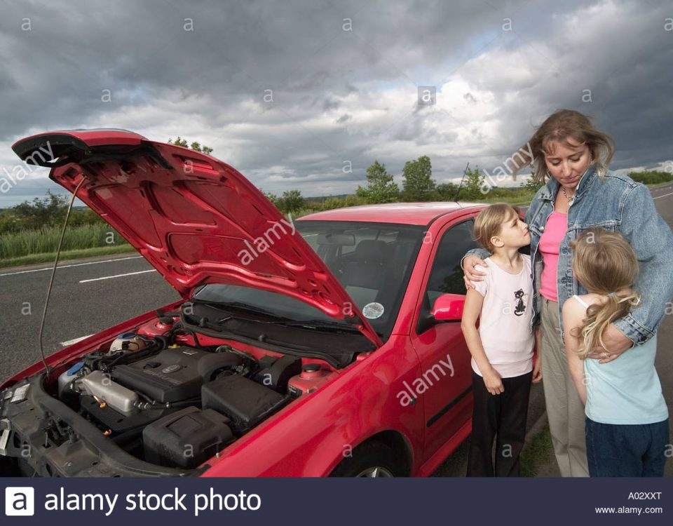 family-with-a-broken-down-car-in-a-layby-awaiting-assistance